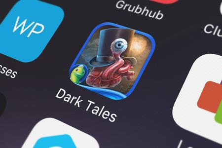 London, United Kingdom - October 05, 2018: Close-up shot of the Dark Tales: Edgar Allan Poe's The Tell-tale Heart - A Hidden Object Mystery application icon from Big Fish Games, Inc on an iPhone. Publikacyjne