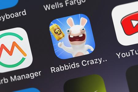 London, United Kingdom - October 05, 2018: Close-up of the Rabbids Crazy Rush icon from Ubisoft on an iPhone. Publikacyjne