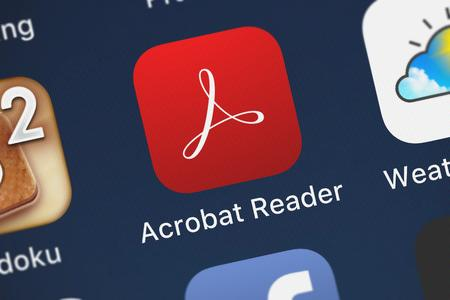London, United Kingdom - October 05, 2018: Close-up shot of the Adobe Acrobat Reader mobile app from Adobe.