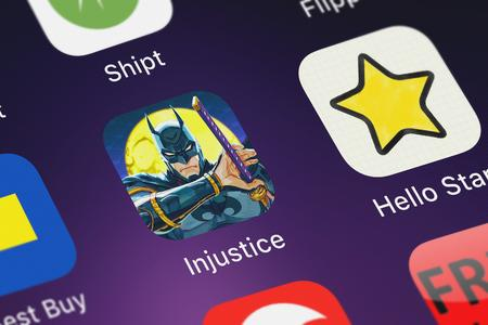 London, United Kingdom - October 07, 2018: Close-up of the Injustice: Gods Among Us icon from Warner Bros. on an iPhone.