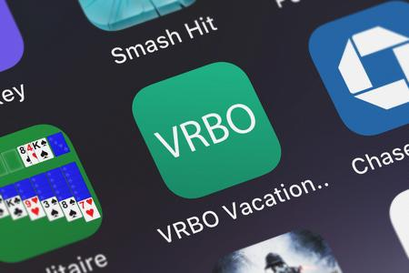 London, United Kingdom - October 07, 2018: Close-up shot of the VRBO Vacation Rentals application icon from HomeAway.com, Inc. on an iPhone.