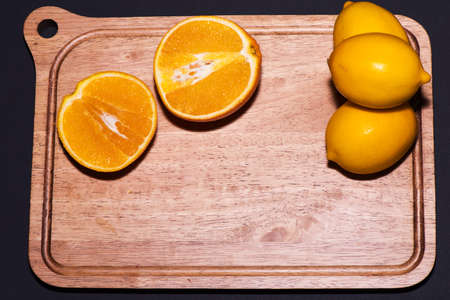 balck: Oranges very nature and lemons with balck Background