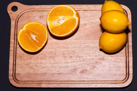 balck: Oranges and lemons with balck Background