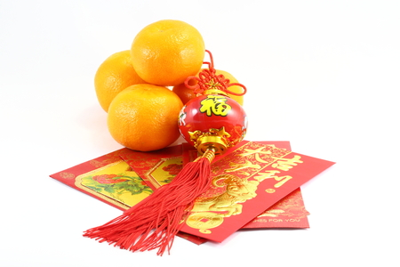 Chinese New Year orange gift envelop and lantern CNY Stock Photo