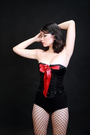 nude female body model: Woman in lingerie black background