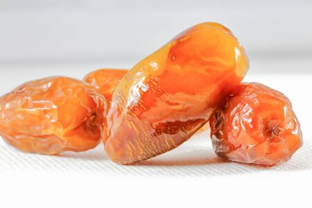 deglet: Dried sweet date fruit  on white background