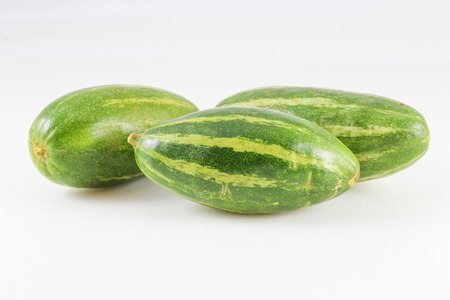 pointed: Pointed gourd green yellow striped exotic Asian vegetable on white background