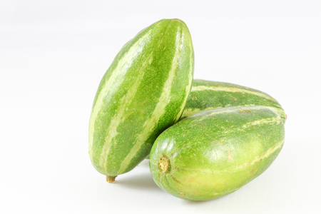 Pointed gourd green yellow striped exotic Asian vegetable on white background