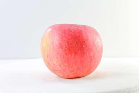 Red Pink Ripe Fuji Apple on white background