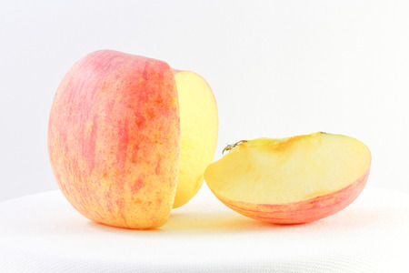 Red Pink Fuji Apple and slice on white background