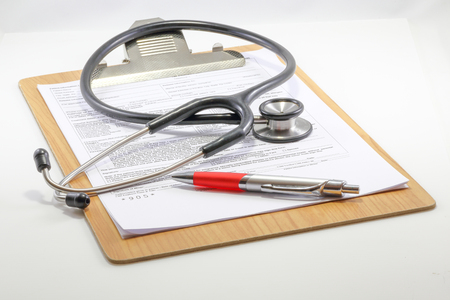 stereoscope: Medical report clipboard with stereoscope pen on white background Stock Photo