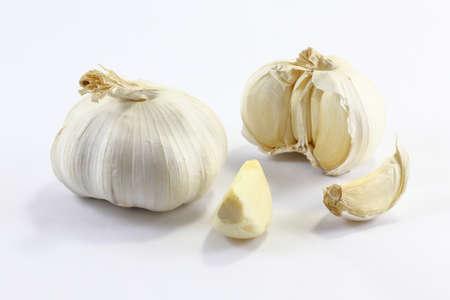 clove: Garlic and garlic clove on white background