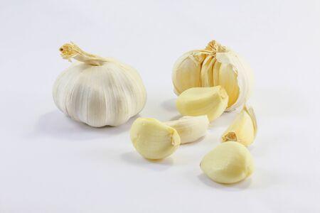 garlic clove: Garlic and garlic clove on white background