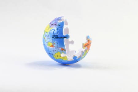 globe puzzle: Incomplete Jigsaw puzzle pieces globe on white background