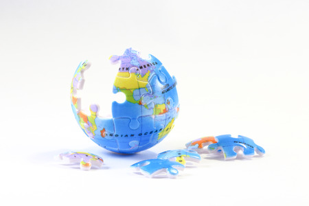 globe puzzle: Jigsaw puzzle globe with unassembled pieces on white background