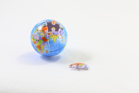 puzzle globe: Jigsaw puzzle globe with open piece on white background
