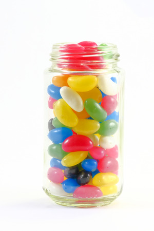 jellybean: Colorful Jellybean candy in a glass jar on white background
