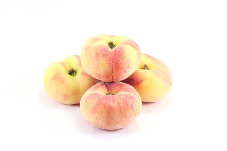 donut shape: Exotic saucer shape Donut Peach Fruit on white background