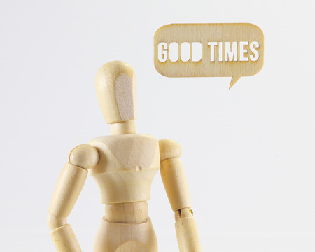 good times: Wooden puppet figure with Good Times word sign on white background