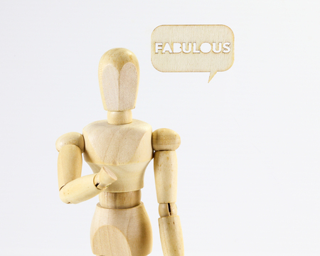 expresion corporal: Wooden puppet figure with Fabulous word sign on white background