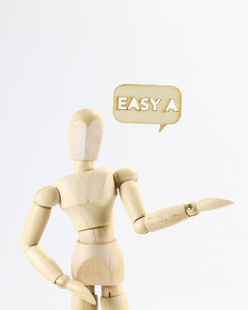 expresion corporal: Wooden puppet figure with Easy A word sign on white background