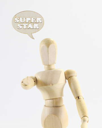 super star: Wooden puppet figure with SUPER STAR  word sign on white background