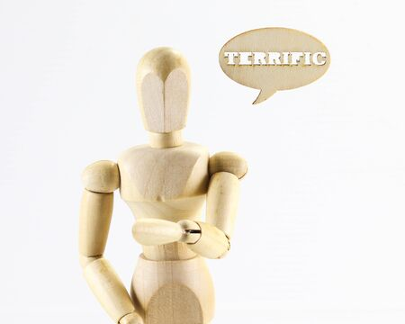 terrific: Wooden puppet figure with Terrific word sign on white background