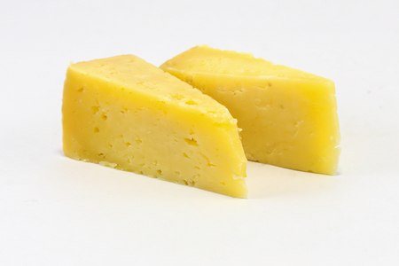 cheez: Cheddar Cheese Triangle cut slice on white background