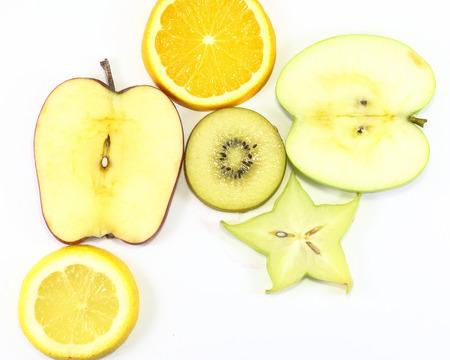 star fruit: Apple kiwi star fruit orange lemon slice on white background fruit art