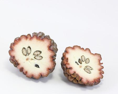 anona: Purple Sugar apple custard apple ata on white background Stock Photo