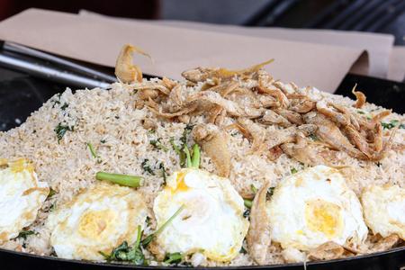 kampung: Fried rice egg prawn salted fish kampong in wok at market food stall