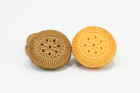 cookies and cream: Chocolate and Lemon orange cream sandwich biscuit cookie on white background