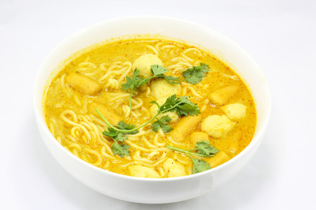 laksa: Noodle curry laksa in bowl on white background Stock Photo