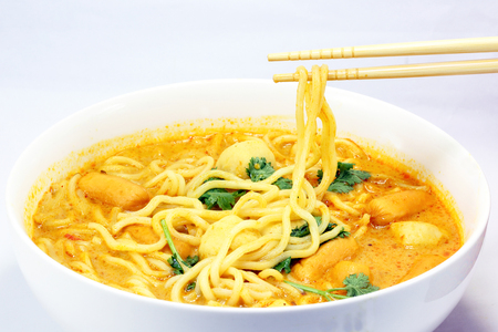Noodle curry laksa in bowl on white background Stock Photo