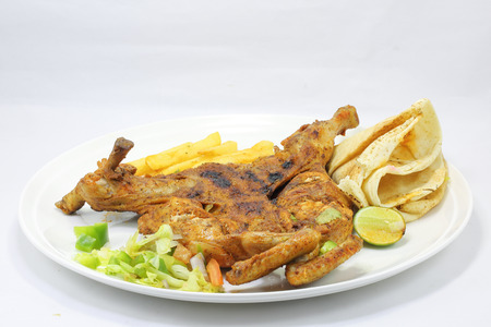 free plate: Grilled whole free range chicken with salad fries sauce Arabic bread lime on plate