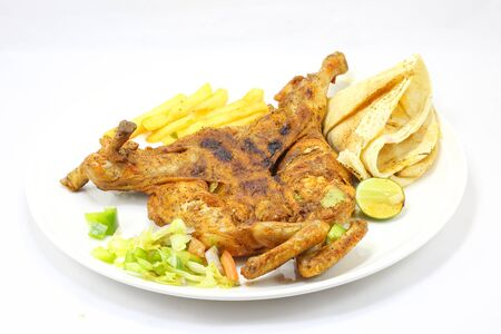 free range: Grilled whole free range chicken with salad fries sauce Arabic bread lime on plate