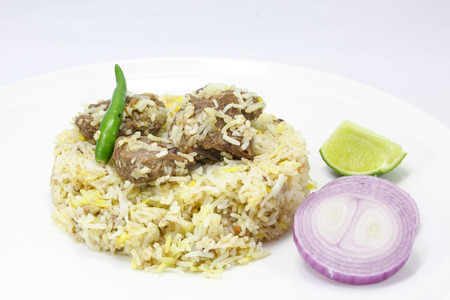 indian mustard: Special Beef Tehari Biryani Rice with chili onion lime on a plate white background