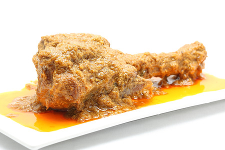 shank: Curry Lamb shank whole roasted lamb leg on white background Stock Photo