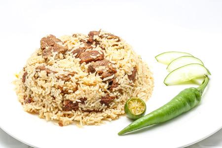 fragrant: Beef Biryani Tehari Rice with chili lime on a plate white background