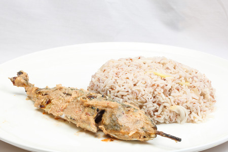 Nasi Dagang Red Rice cooked with coconut milk and spicy with fish chicken