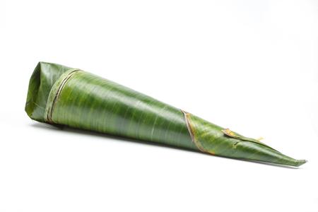 Nasi Tumpang Layer Rice of beef fish egg in banana leaf wrap