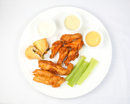 tenders: Chicken buffalo wing salary tender cheese roll appetizer platter dip sauce