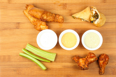 tenders: Chicken buffalo wing salary tender cheese roll appetizer platter dip sauce wooden