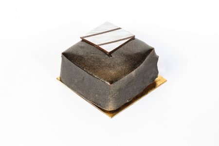 luster: Dark Chocolate cake with golden luster dust on white background