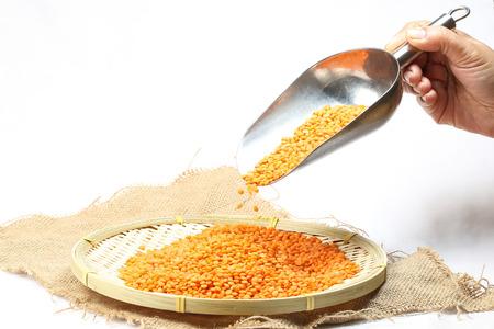 Red Lentils Dal Dhal  seed jute fabric bamboo metal scoop