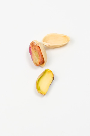 nut shell: Pistachio nut and shell on white background Stock Photo