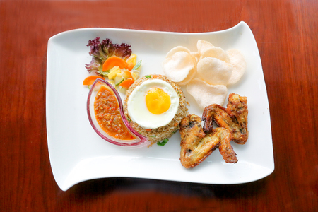 Kampung Fried rice with the deep fried chicken wing poached egg sambal and chips