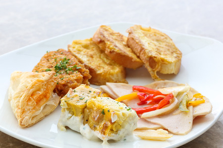 Breakfast set chicken salami hash brown toast slice pastry Stock Photo