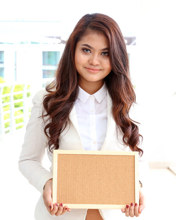 corporate women: Asian young woman smile holding blank board blank space