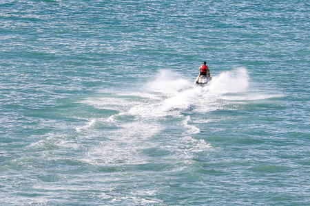 Jet ski rider on sea water splashing outdoor daylight